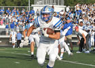 HSE football player running on the field